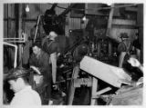 Men working inside Emard Cannery.