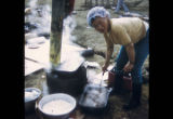 Woman cooking muktuk.