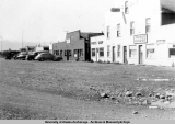 Automobiles parked on street outside businesses in Palmer, 1941