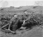 "Stokes and fellow soldier ""Mac""at fox hole."