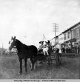 Katherine Claypool (left) with friend and baby in horse-drawn cart.