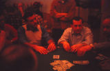 Men playing a poker game.
