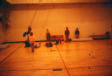 Kids playing in the gym.