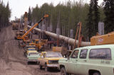 Installing anchors on AS 63, Trans-Alaska Pipeline.