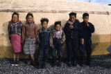 Children - umiak in background.