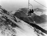Two people on a ski lift, Mount Alyeska.