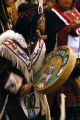 Tlingit drummer in ceremonial dress.