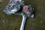 Pieces of high-grade cinnabar and stibnite from Red Devil.