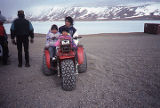 Mother & children at Airport on 3-wheeler.