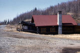 Famous house, now dismantled, beside the Alaska Highway near the bridge over the Tanana River at...