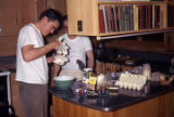 Paul Sellman and Noel Horlocker making a mess in our kitchen at the cabin in Dead End Alley near...
