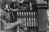 37 mm shells going into breech of gun.