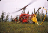 Men and equipment are flown to the fires by helicopter.