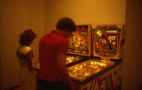 People playing pinball.