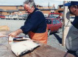 Man filleting halibut.