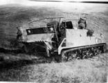 Continuous tread vehicle with soldiers.