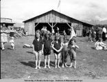 Spenard bathhouse with five children in foreground; ca. 1940.