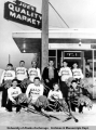 Anchorage youth hockey team outside Joe's Quality Market.