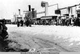 Fur Rendezvous parade on 4th Avenue, Anchorage, 1935-1939.