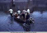 Pulling a boat through flood water, Fairbanks, 1967.