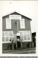 Howard Jonish (on left) standing outside the Kotzebue Grille, ca. 1940's.