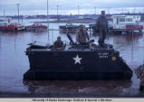 U.S. Army soldiers ride through flood water, Fairbanks, 1967.