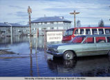 Fairview Manor apartments surrounded by flood water in Fairbanks, 1967.