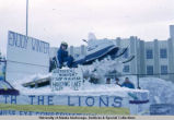 Winter parade float with snowmachine, Fairbanks, 1969.