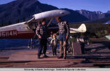 Fishermen and floatplanes at Susitna Lodge, 1970.