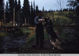 Blackie Zambicki and his lead dog of dog team.