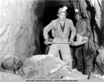 South drift crew mucking out after shot, Independence Mine, 1939.