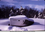 Boat in deep snow.