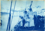 Aleut women and children on the deck of the schooner Olga on Prince William Sound, 1898.