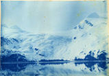 Snow-covered mountains on Prince Willaim Sound, 1898.