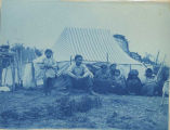 Group photograph in front of a tent, 1898.