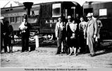 Peter Ferry family in front of Alaska Railroad locomotive, Fairbanks.