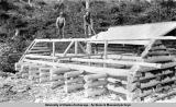 Building dog kennels at Wortmanns [ca. 1910-1920].