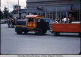 Children riding in miniature train in Anchorage parade.