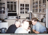 Men at table in Anchorage fire station kitchen.