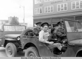 Jeep rides on war stamp day, 1941.