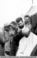 Barbering at Baker Engineers construction camp, Galena 1944-1945.