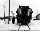 Rusty on back of train at Nenana, March 13, 1940.