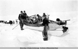 "MGM film crew and dog team with whale boat during production of film ""Eskimo"" 1932-1933."