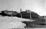 Sod house with whale bones in front, Point Hope, 1932-1933.
