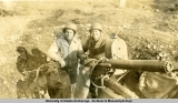 Two servicemen with anti-aircraft artillery, Aleutians, Sept. 1943.