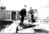 Two servicemen playing horseshoes, Adak 1945.
