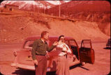 Ralph and Aura Johnson standing along highway to Seward, Alaska.