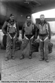 Flight crew in flight suits and carrying parachutes, Adak, 1945.