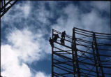 Men working on antenna at Kodiak White Alice Communications site.