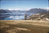 Man in front of lake, Baffin Island.